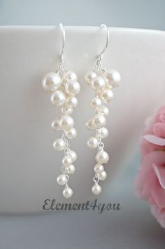 A stunning pair of bridal earring made with all Swarovski ivory pearls of various sizes. Total length measures approximately 2.5 inches long and