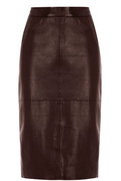 This stand out real leather skirt features a high waist and stitching detail across the fabric for a premium finish. The piece is finished with a concealed zip fastenening on the reverse and a split detail at the bottom of the hem.