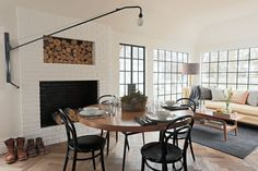 Steel cased windows, open shelving, brass details, impeccable styling and herringbone floors - oh my! This home is the picture of masculine ...