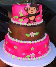 Monkey Girl Baby Shower Cake - Hi, I would like to thank everyone on CC who helped with ideas and information for this cake. This is a vanilla cake with strawberry filling. Buttercream and MMF. I made this cake for my friends daughter baby shower. Thanks for looking :-) *Sorry for the bad pic. I took it last minute with my iphone. So the colors are a little off*