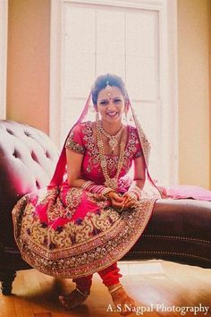 An Indian bride wears a hot pink Anarkali suit for her Punjabi ceremony.