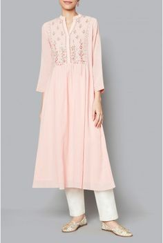 The blush Gaura tunic boasts of its summer floral motifs. With gota patti, kad dana, zardozi, sequin work and dori on its neckline, the georgette tunic is a must have this season. Style Tip: Style this tunic with a pair of white ankle length trousers or as a dress. Fabric: Cotton Georgette Content: 45%COTTON/55%VISCOSE Production time: We require 4 weeks to dispatch this outfit