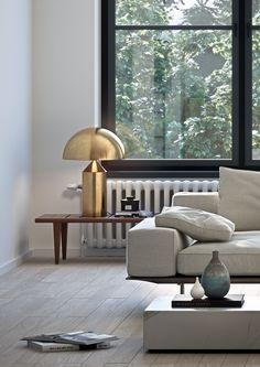 Oscar Properties Stockholm #oscarproperties brass lamp - lamp - sofa - window- table - floor
