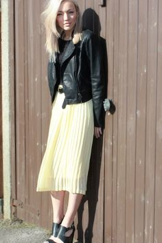 Pale yellow midi-skirt and biker jacket. Lovely tough + sweet combo.