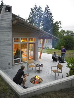 Beautiful bleached siding and wide eaves ... great patio too.  contemporary patio by Goforth Gill Architects
