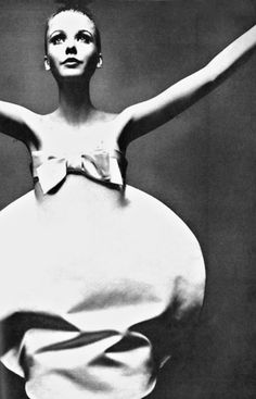 Simple, beautiful dress. Photo by Guy Bourdin for French Vogue, 1969.