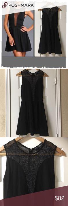 """For Love & Lemons Black Lulu Dress W/Sheer Panels Stunning! For Love & Lemons Black Lulu Dress W/Sheer Silver Metallic Panels. Great shape! Skater dress. Fit & Flare. Back hidden zipper. Rayon/Acrylic/Spandex blend. Nylon/Metallic mesh panels. Spring, summer, rocker, edgy, Designer, modern. Bust 32"""", waist 30"""", length 32"""". For Love and Lemons Dresses Midi"""