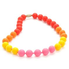 Juniorbeads by Chewbeads Bleecker Jr. Necklace, 100% Safe Silicone - Punchy Pink. Chewbeads is the proud manufacturer of 100% Silicone Teething Jewelry and Accessories. Kid Chic, Play Safe. 100% medical grade silicone that is soft on babies gums and emerging teeth. Chewbeads silicone is easily wiped clean, dishwasher safe and free from BPA, phthalates, cadmium, lead, and metals. Jewelry can be used as a sensory tool and has a breakaway clasp for added safety.