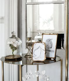 Photo frames in antique-finish metal with decorations. | H&M Home