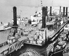 Sections of the Mulberry Harbours loading a large medical unit (on the south coast ?)