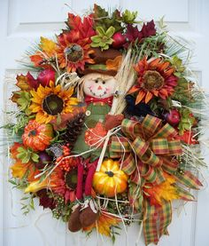 Scarecrow in the Pumpkin Patch Wreath by timelesshomedecor on Etsy For more pumpkin patches and pumpkin goodies, visit www.pumpkinpatch.TV and www.facebook.com/pumpkinpatchTV