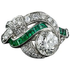 Art Deco 1.97 Carat Center Diamond and Emerald Ring   From a unique collection of vintage engagement rings at https://www.1stdibs.com/jewelry/rings/engagement-rings/