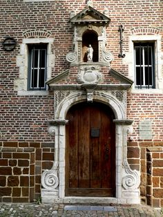 Entrance door Beguinage of Diest (UNESCO), Brabant, Belgium, with Maria chapel on top. Did you know beguinages originated in Belgium in the 1200s?