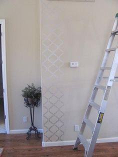 Subtle Moroccan stenciling (silver on beige walls).