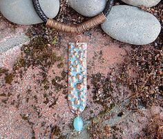 Rainwater Pendant Necklace Instructor: Kat Clark Workshop Fee:  $35 Saturday, October 15 (1-4pm) Water drops on windows is the inspiration for Rainwater Pendant. Students will create texture using various tools, use two patina techniques, and learn a cool bail sized perfectly for leather cording. Previous metal and wireworking experience is required. Materials list