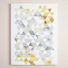 "A series of geometric triangles comprise Onrei's dreamy piece titled ""Gold and Gray Geo."" Born to musician parents in Seattle, Onrei first realized his artistic calling after designing his first show flyer for his parents' band."