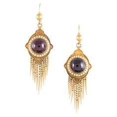 Victorian Bearded Garnet Earrings. 15 karat yellow gold, made in the UK circa 1880, 2 inch long drops with a cabochon garnet center and wonderful bearded, fringe bottoms. Fantastic antique detail, with white enamel and mille grain edges. c 1880
