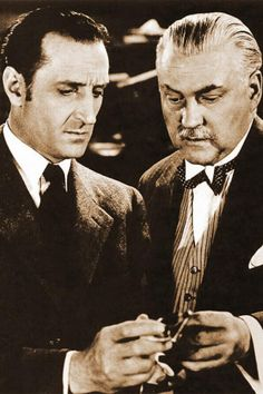 Basil Rathbone as Sherlock Holmes and Nigel Bruce...