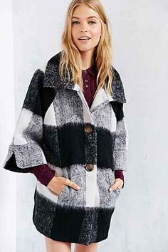 I LOVE this black and white plaid coat.