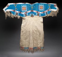A SIOUX BEADED HIDE DRESS. c. 1900