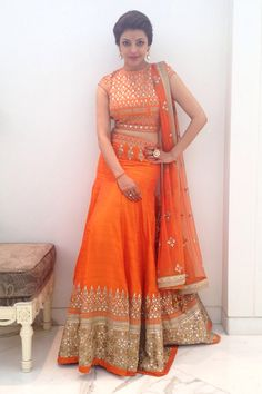 <p><span>Presenting an exquisite orange lehenga adorned with traditional embroidery. It has been paired with a fully embroidered ornage raw silk choli and a net dupatta. A stunning style perfect for the young, trendy and confident bride of today.</span></p><p><span><strong>Fabric Composition: </strong>Raw silk</span></p>