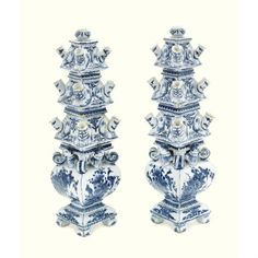 a pair of Dutch Delft blue and white pyramid flower vases, late 17th century / early 18th century