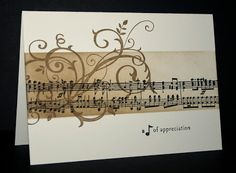 handmade card from Shelley's Stamping Ground .. one layer ... sponging and stmping collage style ... band with sheet music and a flourish ...