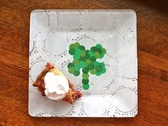 St Patrick craft: shamrock plate. This is a fun way for kids to make a shamrock without having to cut out the shape - they can just punch out circles!