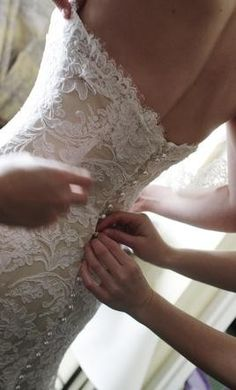 love the lace and the pearl buttons going down the back!-