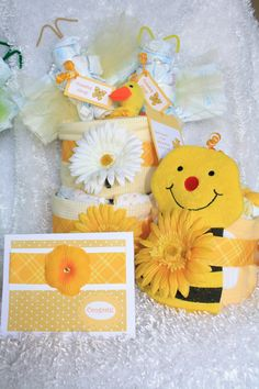 My latest creation - yellow neutral diaper cake set (1 diaper cake, 1 mini diaper cake and 2 diaper butterflies) and matching handmade card