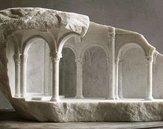 Matthew Simmonds, a British stonemason turned sculptor who carves beautifully finished, miniature architectural scenes into otherwise rough chunks of rock.   http://bldgblog.blogspot.co.uk/2015/11/shell.html?m=1