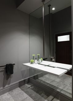 | BATHROOM | Ceiling suspended faucet with mirror wall.
