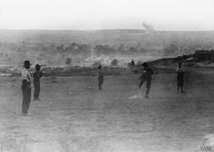 Men of the Australian Army Medical Corps playing football in the evening.