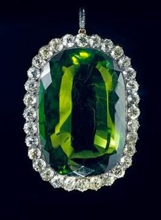 peridot and diamond pendant--- if we have to have the worst birthstone in the lineup, we Can at least surround it with a bunch of diamonds!