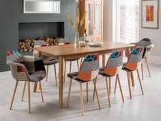 The Brondby Oak Dining Set With Gina Patchwork Chairs has a large oak dining table with 8 patchwork dining chairs. FADS offer Free Delivery with the Brondby Oak Dining Set With Gina Patchwork Chairs