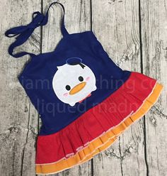Disney Inspired appliqued sweetheart double ruffle peplum top featuring a Tsum Tsum (donald here) Sizes 6 months to 16