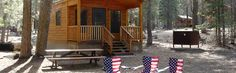 Rustic Cabins Rustic cabins do not have running water, air-conditioning, microwaves or refrigerators. Many cabins have a loft, full-size bed, some with bunk bed, chairs, outdoor and indoor lighting and electrical outlet. All cabin rentals assess a 5% lodging assessment.