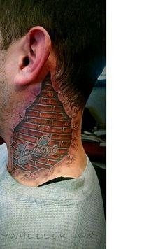 Realistic bricks tattoo by Jay Wheeler