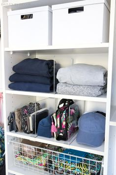 Clear acrylic shelf dividers are the perfect, simple way to organize and keep everything in place in your closet! #closet #organization #organize #organizing #shelf
