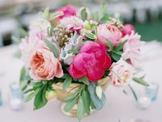 bright and beautiful pink peach and green wedding centrepiece with berries, peonies, and roses | Photography: Michael + Anna Costa Photography - michaelandannacosta.com  Read More: http://www.stylemepretty.com/2015/06/08/rustic-glam-summer-wedding-at-sunstone-winery/