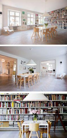 Love these dividerless floor to ceiling bookshelves!