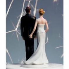 The Love Pinch Cake Topper.... Haha I would die if I caught a glance of the back of this topper at someone's wedding.