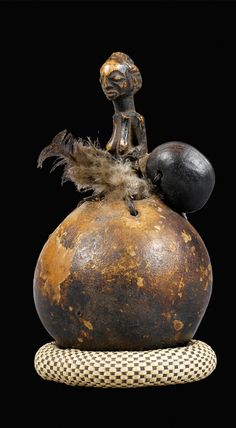 Africa   Rattle from the Luba people of DR Congo   Gourd, wood, feathers and cowbell seed