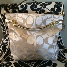 Coach Bag Gold Coach Bag.  Like new, barely used.  Excellent condition.  All gold hardware with brown interior. Coach Bags