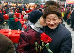 China    Jin Juhua kisses her husband Zhong Weiqiao at a gathering of 60 couples who have been married to each other for over five decades, in Kaihua village of Zhuji city, Zhejiang province, China, on Feb. 14. Jin and Zhong have been married for more than 60 years.