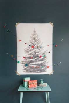 Shining Stars - BijzonderMOOI* - printed image of a tree taped to the wall with separate garland (or maybe even lights) strung on top.