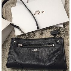 {Coach}  Black grain leather mickie crossbody Soft grained leather in black crossbody accented with silver. The strap is silver chain with leather strap. Measures 8.5 length and 5in Height- comes in coach box and with shopping bag-and tag detached❗️PRICE FIRM❗️in new condition! Used once for about an hour! Coach Bags Crossbody Bags