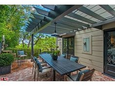 Jeff Lewis Lists His Best Flip Yet: A coat of charcoal paint keeps the wooden trellis in line with the home's contemporary aesthetic.: Another trellis is ripe for hanging bistro lights or planting wisteria. (Gramercy House)