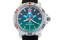 WATCH VOSTOK KOMANDIRSKIE 811021 USSR AIRBORNE TROOPS EMBLEM (W/O NUMERALS). At the top of the turquoise face, at the level of twelve-hour point, there is a red five-pointed star with a white border. In the center, in white and blue colors, there is the emblem of the Airborne Forces of the USSR (VDV) – an open parachute with a five-pointed star on the straps and two planers on the sides.  #russian #mechanical #military #watches #vostok #komandirskie #gifts #souvenirs #airborne #paratrooper
