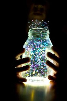 The mason jar in this photo is aglow; it is lit by glow sticks to represent a jar full of fairy dust. The contrast between the exposure in the jar and the dark shadows in the background make the glow even more apparent. Mason Jar Fairy Lights, Fairy Jars, Mason Jar Crafts, Mason Jars, Fun Crafts, Crafts For Kids, Glow Sticks, Glow Stick Jars, Projects To Try